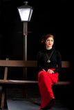 Film noir girl street lantern bench Royalty Free Stock Photos