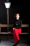 Film noir girl street lantern bench Stock Images