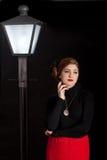 Film noir girl street lantern bench Royalty Free Stock Photo