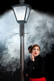 Film noir girl street lantern fog afraid royalty free stock image