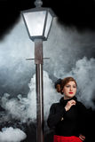 Film noir girl street lantern fog stock photos