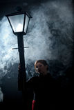 Film noir woman lamppost fog girl royalty free stock images