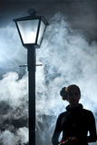 Film noir woman lamppost fog girl stock photography