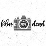 Film is not dead.Black and white print with film photocamera on grunge background. Film is not dead.Black and white print with film photocamera on grunge Stock Photos