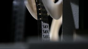 Film with the old movie is wound on a reel