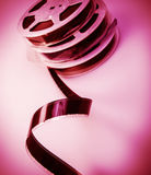 Film. Old reel of film of 16 mm on a pink background Stock Images
