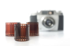 Film photography. Negative film and analog camera in background. selective focus. horizontal image Royalty Free Stock Photos