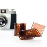 Film photography. Film roll with old camera in background. selective focus. square image Stock Photos
