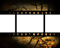 Film pieces on grunge background. Film pieces on grunge dark background Royalty Free Stock Photos