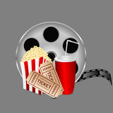 Film with popcorn and a drink. On a gray background Stock Photo