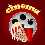 Film with popcorn and a drink. On a red  background Stock Images