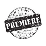 Film premiere rubber stamp. Black grunge rubber stamp with the text film premiere written inside the stamp Stock Images