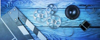Film production. Antique art background blue camera cinema stock images