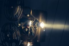 Film projector with dramatic lighting. High contrast image Royalty Free Stock Images