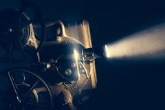 Film projector with dramatic lighting. High contrast image Royalty Free Stock Photography