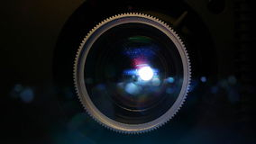 Film projector lens. Front view of digital film projector lens in action stock video footage