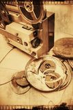 Film projector and film reels. On a wooden floor stock photo