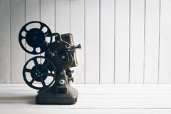 Movie projector on a white wooden background. Film projector on a white wooden background Royalty Free Stock Photos