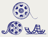 Film reel. Vector. Doodle style royalty free illustration
