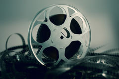Film reel. With celluloid around green atmosphere Stock Images