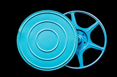 Film reel. Film case with film reel on black background, add text or copy to case area, copy space Royalty Free Stock Images