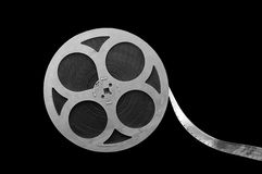 Film reel. Metal film reel on a black background stock illustration