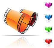 Film reel. Colourful film reels and reflections on white Royalty Free Stock Images