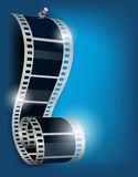 Film reel on blue backgorund. Film reel with stud on blue background Stock Image