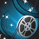 Film Reel on Blue Background. 