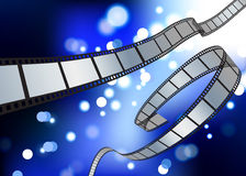 Film reel blue glow internet background Royalty Free Stock Photos