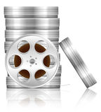 Film reel and box. Es on white background Royalty Free Stock Photo