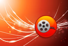 Film Reel Button on Red Abstract Light Background Royalty Free Stock Photos