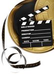 Film reel and cinema clap. A black film case reel and a cinema clap isolated on white Royalty Free Stock Photo