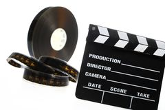 Film reel and cinema clap Stock Photography