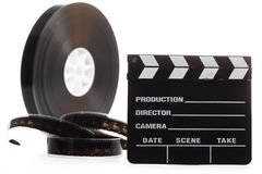Film reel and cinema clap Stock Images