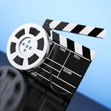 Film Reel with Cinema Tape near Clapboard. 3d Rendering. Film Reel with Cinema Tape near Clapboard on a blue background. 3d Rendering Royalty Free Stock Image