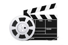 Film Reel with Cinema Tape near Clapboard. 3d Rendering. Film Reel with Cinema Tape near Clapboard on a white background. 3d Rendering Stock Images