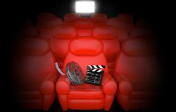 Film reel with clapboard in cinema. 3d Stock Images