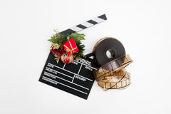 Film reel and clapper board with christmas decoration. Isolated on white background Royalty Free Stock Photos