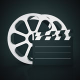 Film reel and clapper. On dark background. Mock up, 3D Rendering Royalty Free Stock Photo
