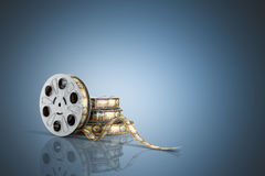 Film reel with a film strip 3d render on blue Royalty Free Stock Photos