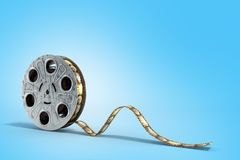 Film reel with a film strip 3d render on the blue background. Film reel with a film strip 3d render on the blue Stock Photo