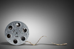 Film reel with a film strip 3d render on grey Royalty Free Stock Photos