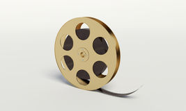 Film reel with a film strip Stock Photo