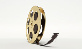 Film reel with a film strip Stock Photography