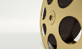 Film reel with a film strip. On the withe background Stock Images