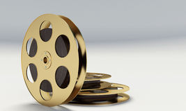 Film reel with a film strip. On the withe background Royalty Free Stock Photos