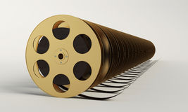 Film reel with a film strip Royalty Free Stock Images