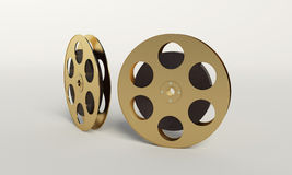 Film reel with a film strip. On the withe background Stock Photo