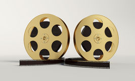 Film reel with a film strip. On the withe background Stock Photography